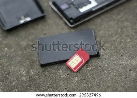 Lost sim card and mobile phone, concept of security of personal data, shallow depth of field shot - stock photo