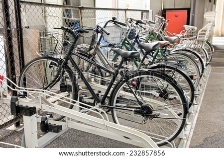Lot of bicycles at a bike parking in Tokyo. Japan. 127 million people in Japan have 72 million bicycles. - stock photo