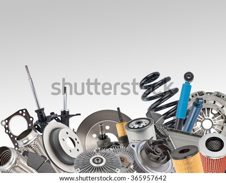 Lot of car spare parts on white - stock photo
