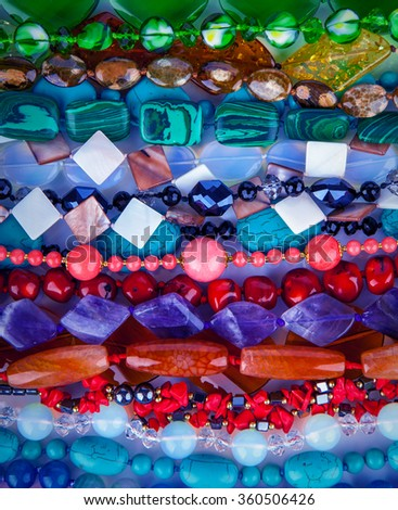 Lot of colored beads from different minerals and stone - stock photo