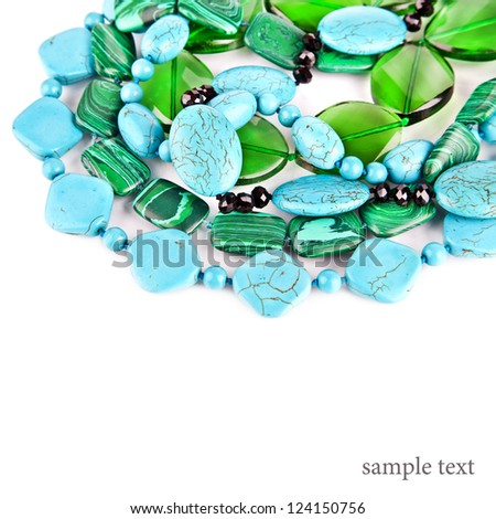 Lot of colored beads from different minerals. Stone background - stock photo