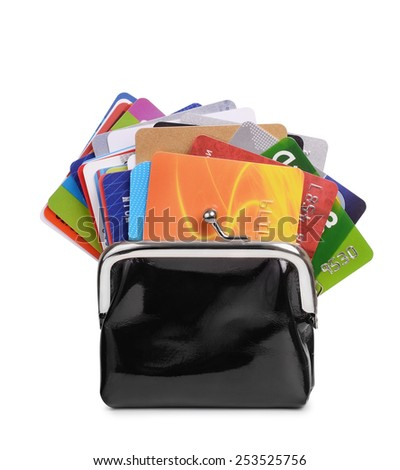 Lot of credit cards in purse isolated on white - stock photo