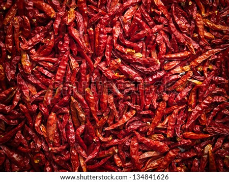 Lot of dried chili as a food background. - stock photo