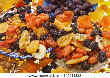lot of dried sweet fruits on asian plates