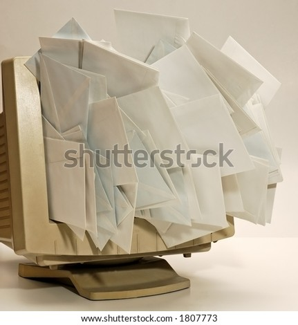 lot of envelopes getting out the monitor screen - stock photo