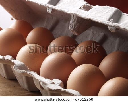 Lot of  fresh brown eggs. Egg carton detail. - stock photo