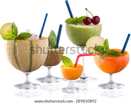 lot of fruit cocktail on bright backgroun