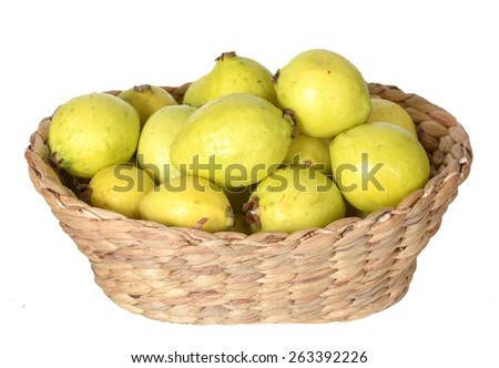 lot of guava in basket isolated on white  - stock photo