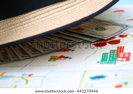 Lot of money under the straw panama hat - stock photo