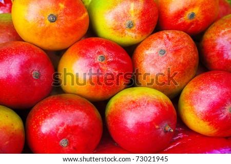 lot of red fresh mango fruits. background - stock photo