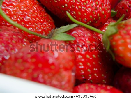 Lot of red ripe strawberries - food background