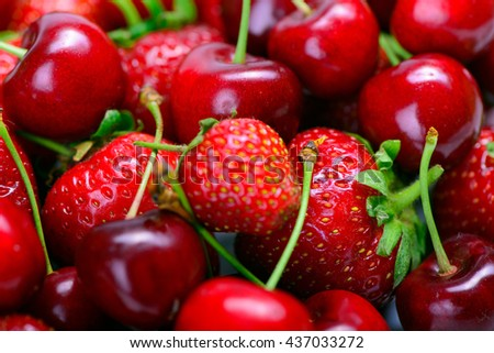 lot of strawberries and cherry as background