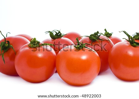 lot of tasty red tomatoes isolated on white