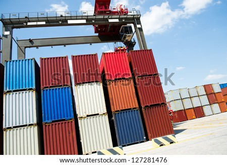 Lot's of cargo freight containers in the container terminal. - stock photo