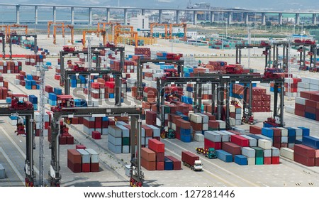 Lot's of cargo freight containers in the port. - stock photo