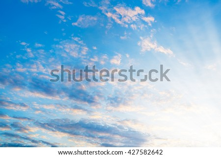 lot white fluffy clouds on blue summer sky with sunlight abstract texture background - stock photo