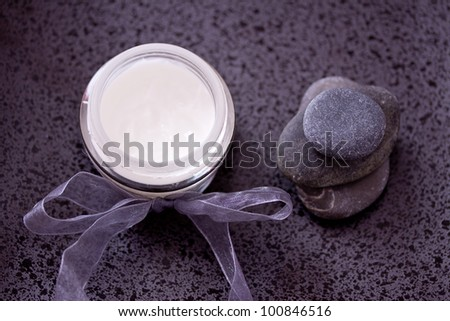 lotion and zen stones for a daily spa image