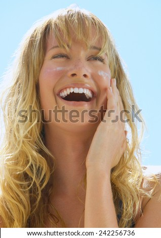 Lotion Woman Applying Sunscreen Solar Cream - stock photo