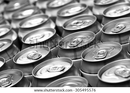 Lots aluminum beer cans. Black and white image. Shallow DOF! - stock photo
