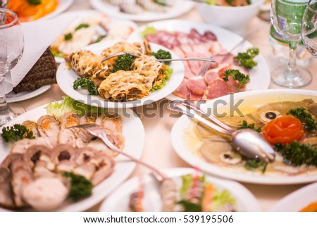 Lots appetizers on a table in a restaurant.