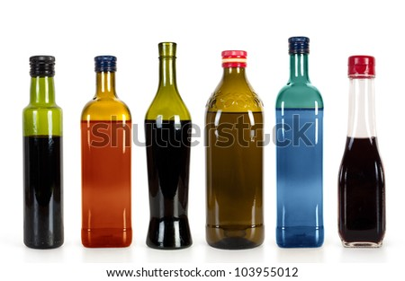 Lots bottles of various  drinks isolated over white background - stock photo
