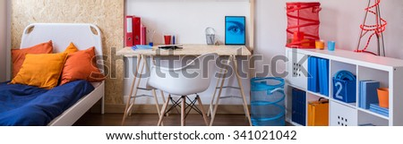 Lots of accessories in young boy's room  - stock photo
