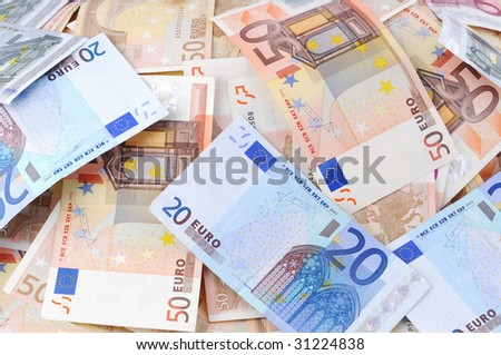 Lots of 50-, 20- and 5-Euro banknotes - stock photo