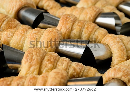 Lots of baked cones just after baking - stock photo