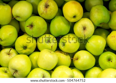 Lots of bright green apples in supermarket.