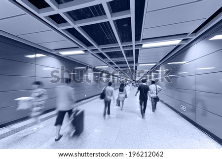 lots of business people walk at subway station abstract blur