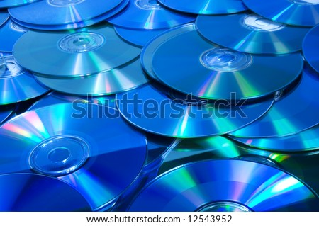 lots of CD/DVD disks from above - stock photo