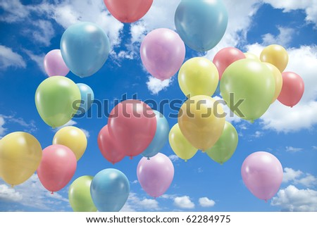 Lots of colorful balloons flying in the air - stock photo