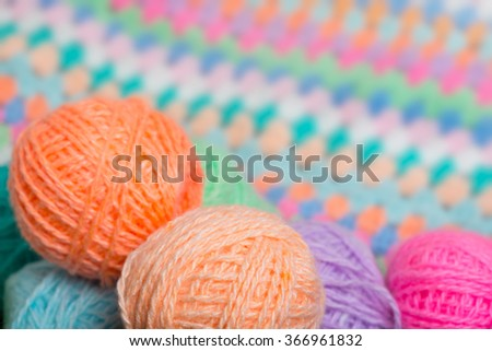Lots of colorful balls of yarn - stock photo