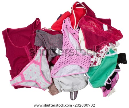 Lots of colorful clothes isolated on white background. Clipping paths included. - stock photo