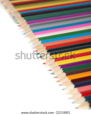 lots of colorful crayons on a white background