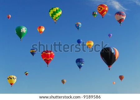 Lots of colorful hot air balloons floating in the sky - stock photo