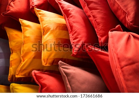 lots of colorful pillows in different patterns - stock photo