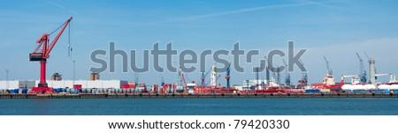 lots of cranes in rotterdam harbor - stock photo