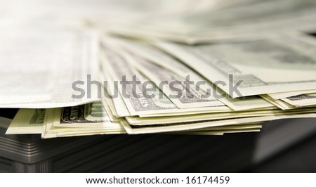 Lots of dollar bills close-up in opened suitcase