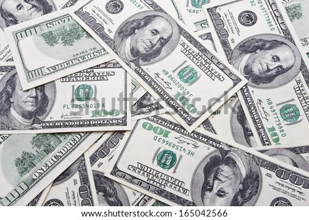 Lots of dollar notes arranged in chaotic manner, background - stock photo