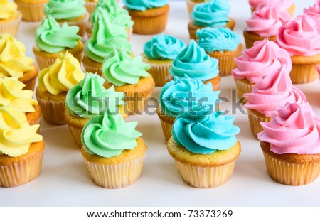lots of fancy rainbow cupcakes - stock photo