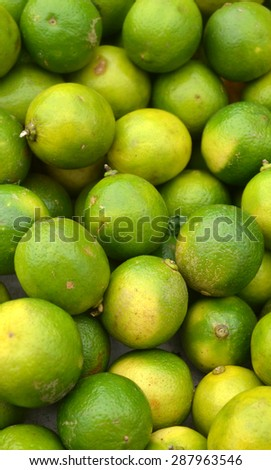 Lots of fresh green limes at the market