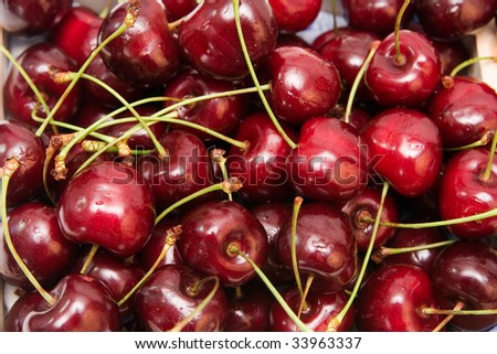 lots of fresh, red cherries. summer background