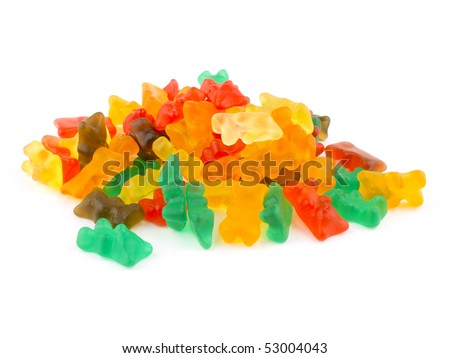 Lots of gummy bears on white background. - stock photo