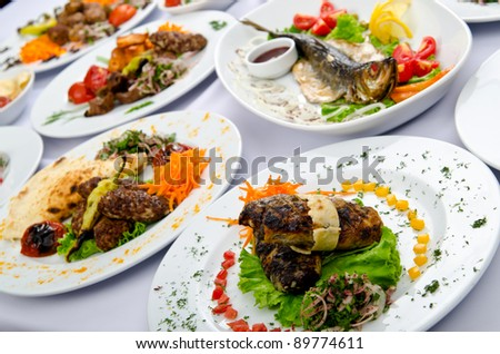 Lots of meals served on table - stock photo
