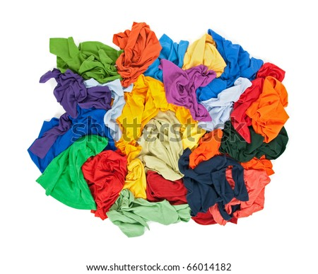 Lots of messy colorful clothes, view from above, isolated on white background.