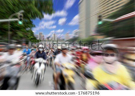 Lots of Motorcycles on the Streets of Saigon, Vietnam with Zoom Blur - stock photo