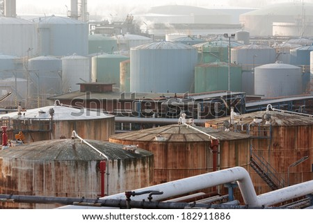 Lots of New and Old Storage Tanks - stock photo