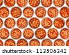 Lots of open tins of baked beans - stock photo