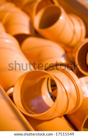 lots of orange pvc pipes - stock photo